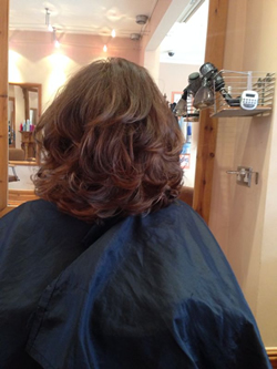 After, cut into a layered bob with centre parting and finished with volume creating bounce and flexibility.