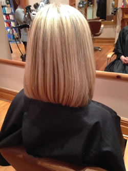 After medium length hair to a thicker, fuller shoulder length bob. Rear view.