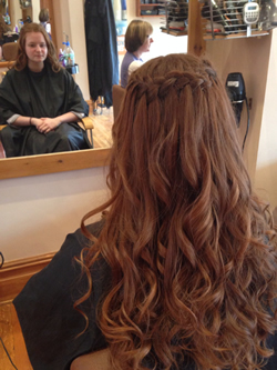 Curled with ghd straighteners and a waterfall plait added for a loose bohemian prom look. Back View