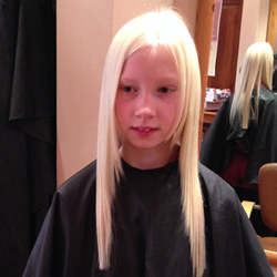 Long hair with one length cut adds thickness to the style, and some shape around the front creates softness. Ghd irons were also used to smooth the hair and complete the finished look. Front View