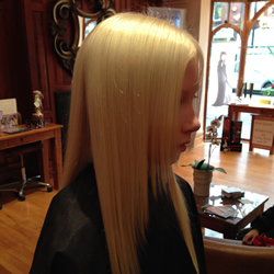 Long hair with one length cut adds thickness to the style, and some shape around the front creates softness. Ghd irons were also used to smooth the hair and complete the finished look. Right Profile