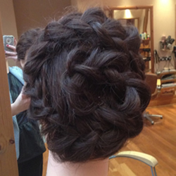 Hair done in an up style at the hair and beauty centre marple