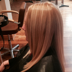 Lady with her hair coloured and styled hair at the hair and beauty centre marple. Left profile