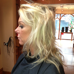 Blonde lady before getting her hair coloured at the hair and beauty centre marple. Left profile