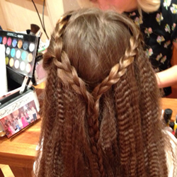 Party time girls hair styled with crimping and plaits